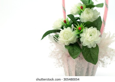 Bouquet from artificial flowers arrangement centerpiece on white background