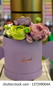 A bouquet of artificial roses in gift wrapping.