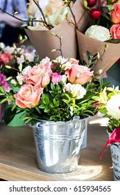 A bouquet of beautiful flowers - roses. A shelf in a flower shop, flower fairs, a market.