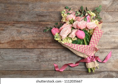 Bouquet of beautiful fragrant flowers on wooden background