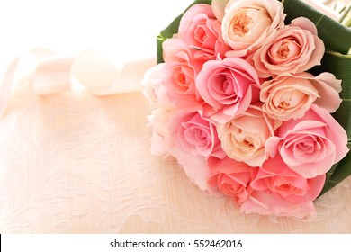 Bouquet of beautiful pink roses on the dressing stool