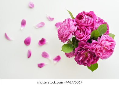 Bouquet of beautiful pink roses and petals background. Top view flowers background.
