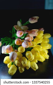 Bouquet of beautiful tulips on table