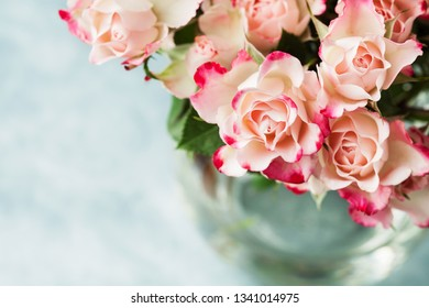 Bouquet of beautiful white pink roses in vase