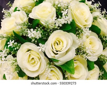 Bouquet of beautiful white roses isolated on black for background. A great gift to a woman for an anniversary, birthday, valentine's day or wedding