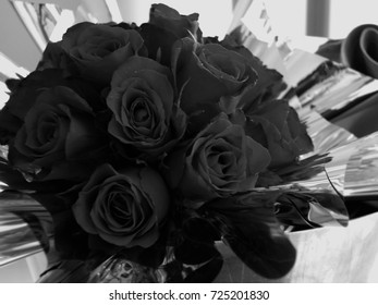 Bouquet black roses background. greeting card.