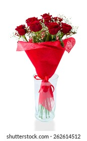 Bouquet of blossoming dark red roses in vase isolated on white background