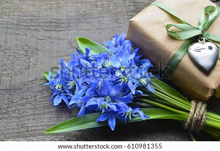 Bouquet Of Blue Scilla Squill Flowers And Gift Box With Vintage Silver Heart On