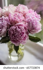 Bouquet of blurred pink peonies, perfect for background. Vibrant flowers. Selective focus.