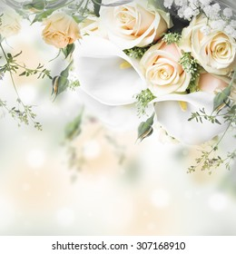 Bouquet for the bride of yellow roses and white calla lilies, floral background.