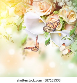 Bouquet for the bride of yellow roses and white calla lilies,  butterfly.