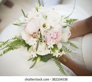 Bouquet in the bride's hands