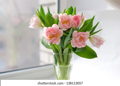 a bouquet of bright pink tulips