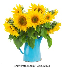 bouquet of bright sunflowers  in blue vase isolated on whute