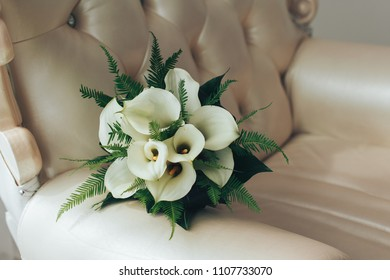 a bouquet of callas. A beautiful and exquisite bouquet of white callas for the bride. a bouquet of flowers callas. bridal bouquet.