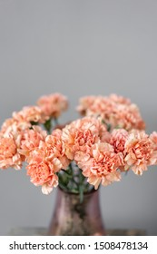 Bouquet of carnation flowers peach color. Spring background. Clove bunch present for Mothers Day.