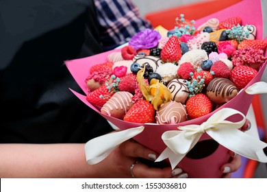 A bouquet of chocolate covered strawberries with different toppings like chocolate coconut cocoa almonds nuts. Chocolate Strawberry Fondue.