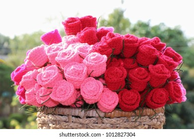 Bouquet of colorful crochet roses in basket and blur background, Handmade crochet flowers, Valentine's Day and Love concept.