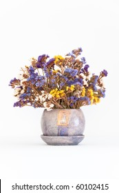 Bouquet of colorful dried sea lavender (Limonium) in matching purple jug on isolating background(vertical)