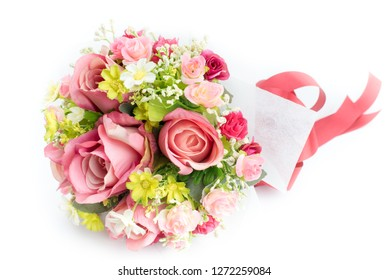Bouquet of colorful fake flowers, isolated on white background.