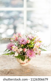 Bouquet of colorful flowers arranged in small vase