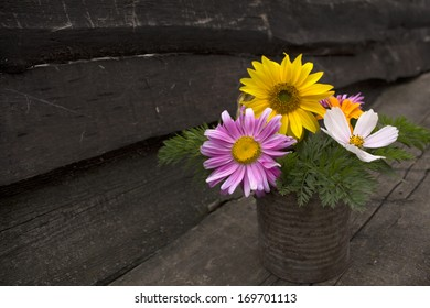 Bouquet of colorful flowers on a wooden board. Photo.