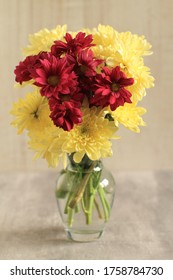 Bouquet of colorful mini chrysanthemum flowers in a vase on a table