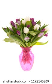 Bouquet colorful mixed tulips in green glass vase isolated over white background