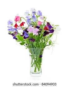 Bouquet of colorful sweet pea flowers in glass vase