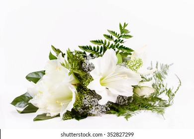 Bouquet composition with white amaryllis on white background