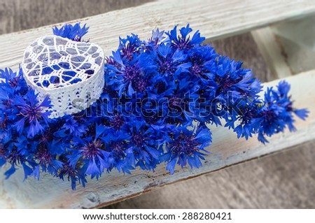 Bouquet of cornflowers with the heart.Intentional blur. Concept of love.