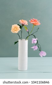 Bouquet of crepe paper roses and sweet peas in a vase