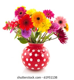 Bouquet of Dahlia flowers in red dotted vase
