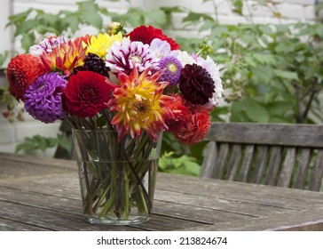 Bouquet of dahlias in a vase on a garden table