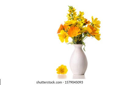 Bouquet of daisies, calendula in a white vase on a white background.