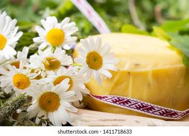 bouquet of daisies and cheese with fern and ribbon. symbolism of Latvia for Ligo holiday