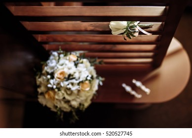 bouquet of delicate roses with elements of the wedding decor
