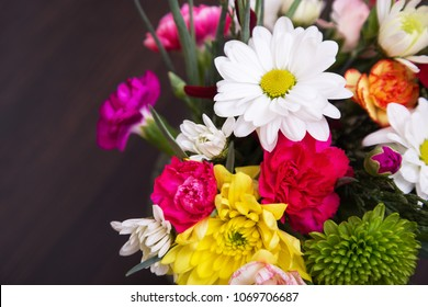Bouquet of different flowers close-up. Bouquet of flowers, place for text. Congratulate with the holiday