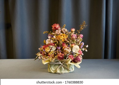 Bouquet of dried flowers herbarium on a grey background