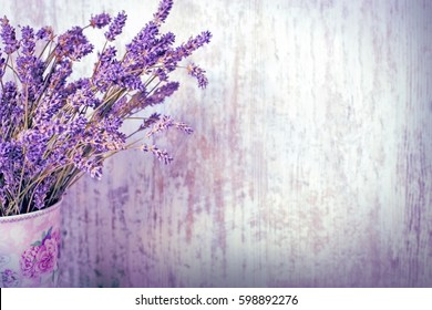 Bouquet of dry (dried) lavender in vase with rustic wooden background