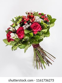 bouquet of exotic flowers with red roses isolated