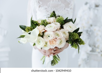 bouquet of exquisite flowers of pink buttercups for the bride