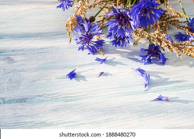 bouquet of field flowers  , Bright blue flowers made of cornflower on a wooden background
