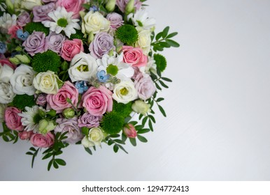 Bouquet of flovers and two hearts on white background