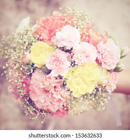 Bouquet of flower in hand with retro filter effect