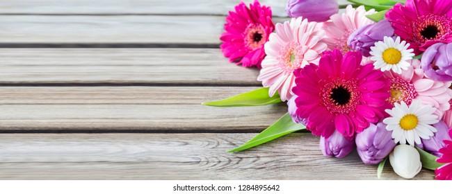 Bouquet of flowers against wooden board
