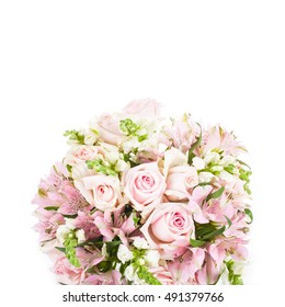 bouquet of flowers delicate pink roses and other green leaves isolated on white background