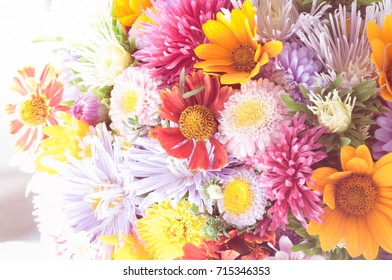 Bouquet of flowers. Different summer flowers background. Vintage photo. Selective focus.
