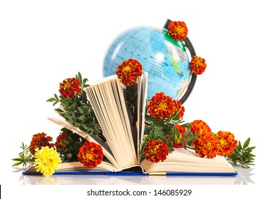 bouquet of flowers and a globe on the day the teacher