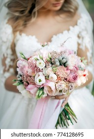 bouquet of flowers in the hands of the bride